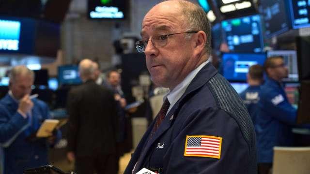 〈美股早盤〉市場緊盯Fed利率決議及政策動向 美股漲跌互現 (圖:AFP)