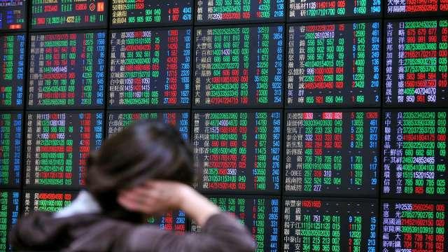 台股終場上漲82.75點,收在今日最高點。(圖:AFP)