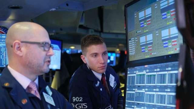 續爆天量!Fed 隔夜附買回操作規模來到7471億美元(圖片:AFP)