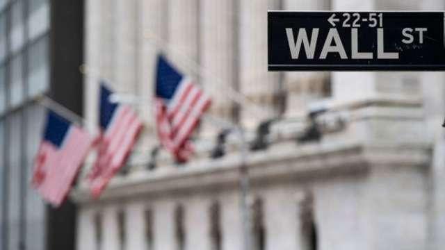 銀行壓力測試將揭曉 華爾街1300億美元股利、庫藏股蓄勢待發 (圖:AFP)