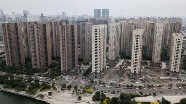 房市調控、資金緊縮 中國多地房貸利率上調(圖片:AFP)
