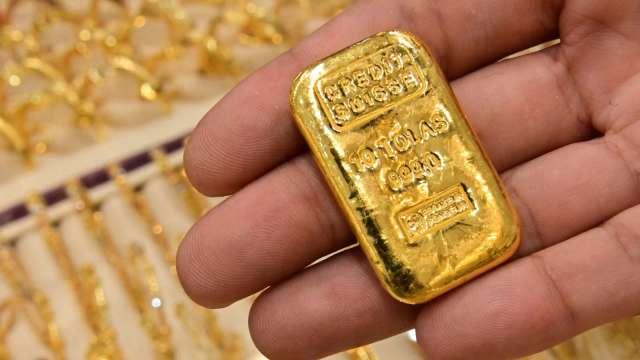 〈貴金屬盤後〉美股走強 風險胃口旺盛 黃金下跌但本週仍走高 (圖片:AFP)