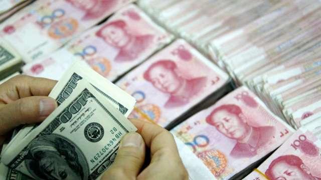中國央行:將深化匯率市場化改革 增強人民幣匯率彈性(圖:AFP)