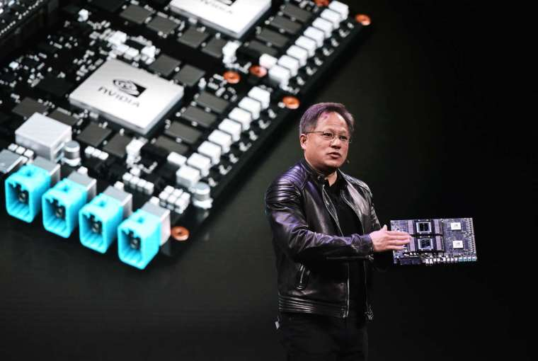 Nvidia 執行長黃仁勳有信心明年 3 月底以前完成 Arm 收購 (圖片:AFP)