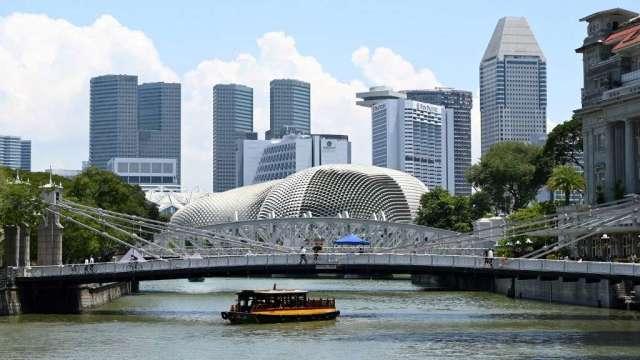 新加坡金管局:金融部門上半年成長6% 需對房價高漲保持警戒(圖:AFP)