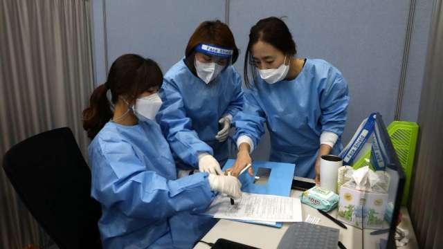 疫情升溫 南韓考慮實施最嚴格防疫措施(圖:AFP)