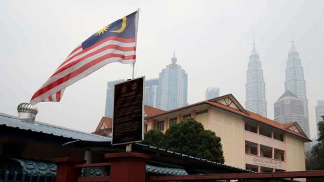 馬來西亞疫情未見放緩。(圖:AFP)