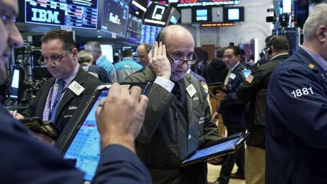 永豐金證券宣布領先同業自即日起開辦美股定期定額經紀業務。(圖:AFP)