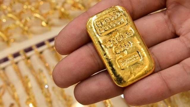 〈貴金屬盤後〉黃金連漲3週 且創7週來最大單週漲幅  (圖片:AFP)
