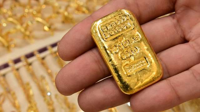 〈貴金屬盤後〉美元上漲 美股近高點 黃金回落 但連4日守住1800美元上方 (圖片:AFP)