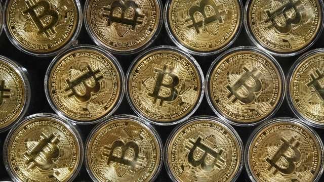 加密貨幣負面消息不斷 6月交易量慘摔逾4成(圖片:AFP)