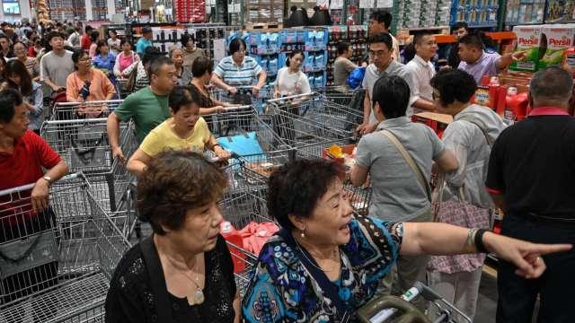中國6月零售銷售年增12.1% 優於預期(圖片:AFP)