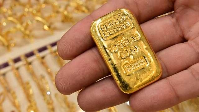 〈貴金屬盤後〉黃金逆轉早盤跌勢 連3日收漲 登1個月高點 (圖片:AFP)