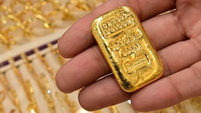 〈貴金屬盤後〉美元、公債殖利率上升 掐斷黃金3日漲勢 但週線4度上升 (圖片:AFP)