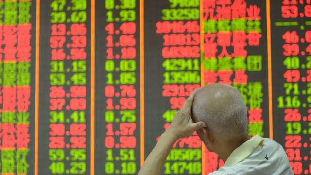 A股1700家公司業續預告 七成有喜訊(圖片:AFP)