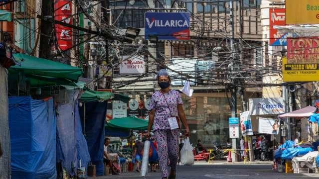 亞洲疫情持續延燒 變種病毒促投資人拋售(圖片:AFP)