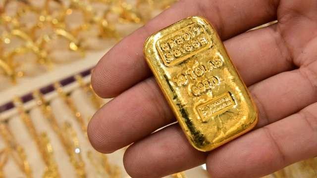 〈貴金屬盤後〉ECB採鴿派 美請領失業救濟人數增 黃金溫和收高 (圖片:AFP)