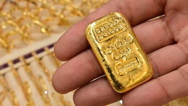 〈貴金屬盤後〉迎接Fed會議 黃金跌破關鍵1800美元 收3週最低點 (圖片:AFP)