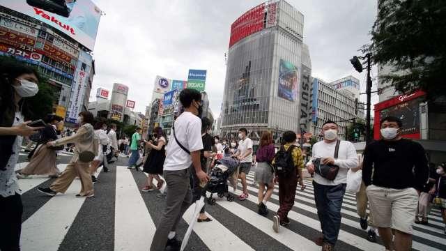 東京單日新增確診創高!20多歲年輕族群明顯突出 (圖片:AFP)