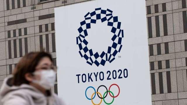 東京新增確診衝破3000人!連續兩天創高 (圖片:AFP)