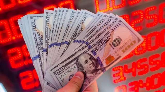 〈台幣〉股匯脫鉤 強勢轉升收28.005元。(圖:AFP)