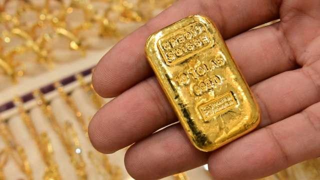 〈貴金屬盤後〉美股、美債殖利率、美元均走揚 黃金收低 (圖片:AFP)