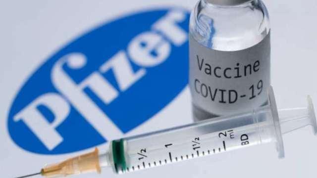 病毒難纏疫苗股夯 輝瑞股價刷新高、莫德納近一個月漲約80% (圖:AFP)