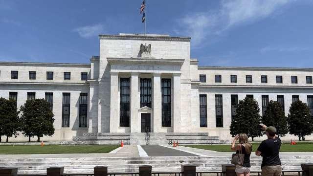 Fed會議紀要暗示 準備今年開始縮減購債 (圖片:AFP)