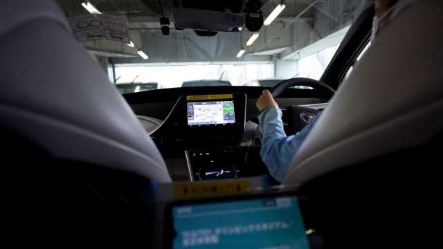 軟體為自駕車差異化競爭核心。(圖:AFP)