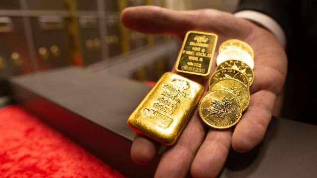 金價站回1800美元關鍵價位 靜待全球央行年會動向。(圖:AFP)