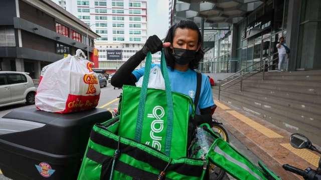 疫情衝擊東南亞 經濟學家下調馬來西亞等國成長預測(圖:AFP)