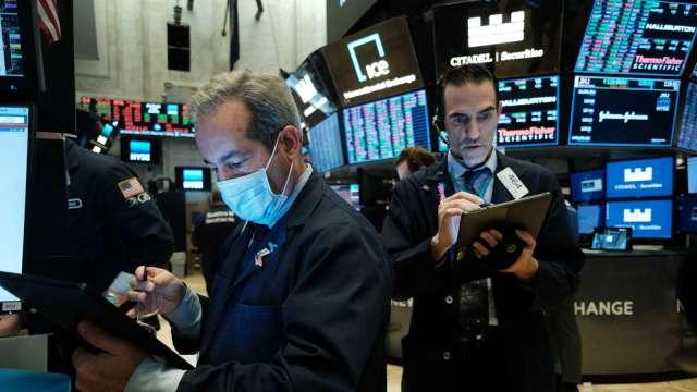銀行股好兆頭!美銀:銀行再次執行庫藏股 手筆大於科技業 (圖片:AFP)