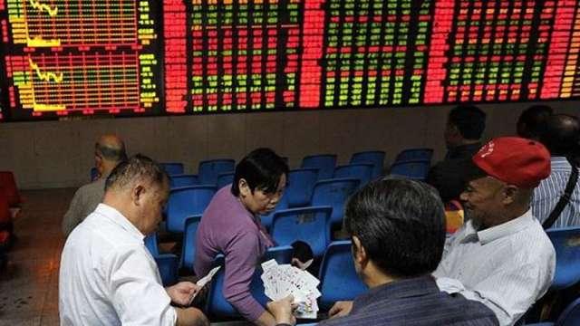 A股37天交易量累計50兆元人民幣 市場點名五大推手(圖:AFP)