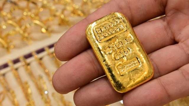 〈貴金屬盤後〉美元上漲 黃金跌回1800美元下方 5週來首次收低 (圖片:AFP)