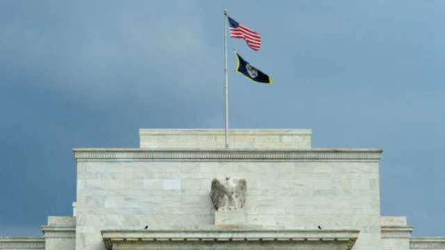 Fed官員去年頻繁進出股市遭非議 改革聲音漸起 (圖:AFP)