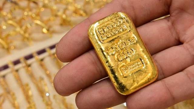 〈貴金屬盤後〉Fed會議前一週 黃金上漲 但未能突破1800美元關卡 (圖片:AFP)