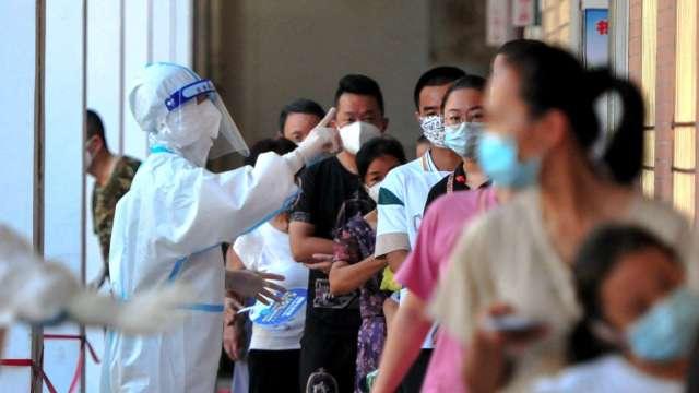 中國福建COVID-19本土新增確診 13日增加一倍以上 (圖片:AFP)