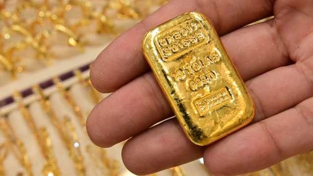 〈貴金屬盤後〉Fed會議前 黃金持續盤整 回吐昨日漲幅 (圖片:AFP)