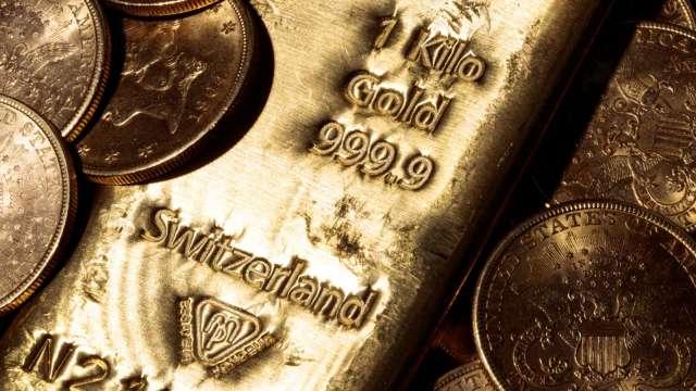美國經濟前景改善 黃金價格恐續跌(圖片:AFP)