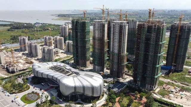 聯博示警:恒大破產恐對中國房產業形成骨牌效應 (圖:AFP)