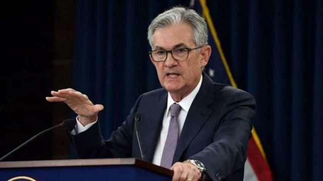 聯準會主席鮑威爾立場轉鷹派,市場關注何時啟動縮。(圖:AFP))