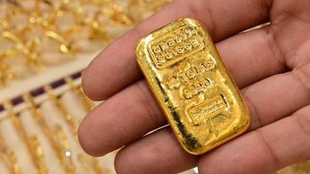 〈貴金屬盤後〉Fed轉鷹 市場追求風險 黃金跌至6週低點(圖片:AFP)
