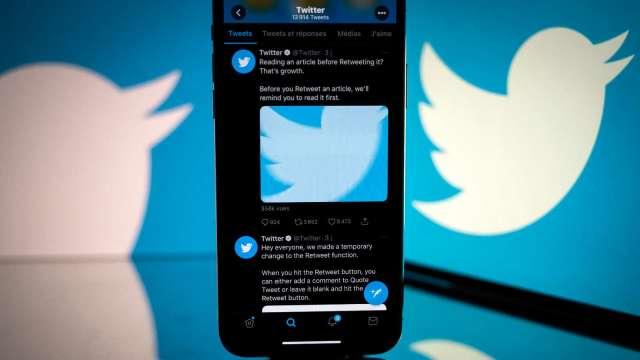 推特新增比特幣打賞功能 未來將推NFT大頭貼認證。(圖:AFP)