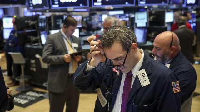 加密相關股票因中國政策下挫 微博傳提交港股上市申請 (圖:AFP)