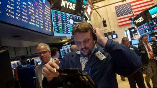 美國將縮減購債 成熟股市不跌反漲。(圖:AFP)