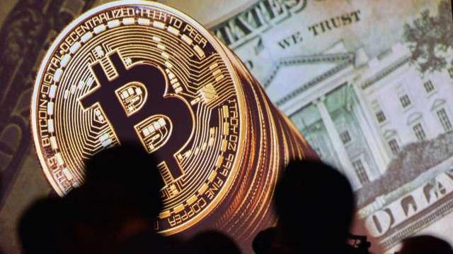 中國封殺加密貨幣不令人意外 部分投機者視此為買入機會(圖:AFP)