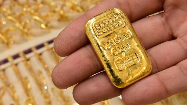 〈貴金屬盤後〉IMF削弱美成長前景 黃金4日來首漲 登1週高點 (圖片:AFP)