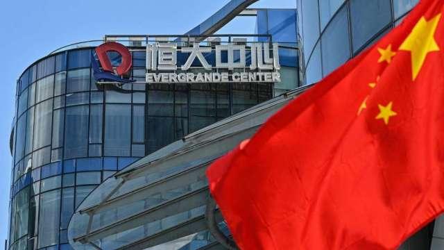 大摩上調中國房產業評級:系統風險可控 政策拐點將至(圖:AFP)