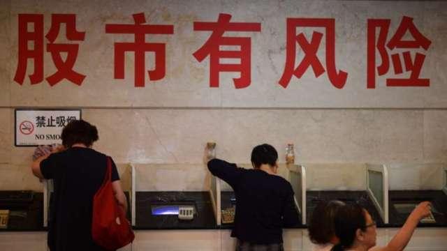〈陸港盤後〉銀行、白酒再撐腰 上證順利翻紅上漲0.4%(圖片:AFP)