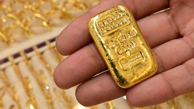 〈貴金屬盤後〉CPI數據引發抗通膨買盤 黃金漲至1個月高點 (圖片:AFP)